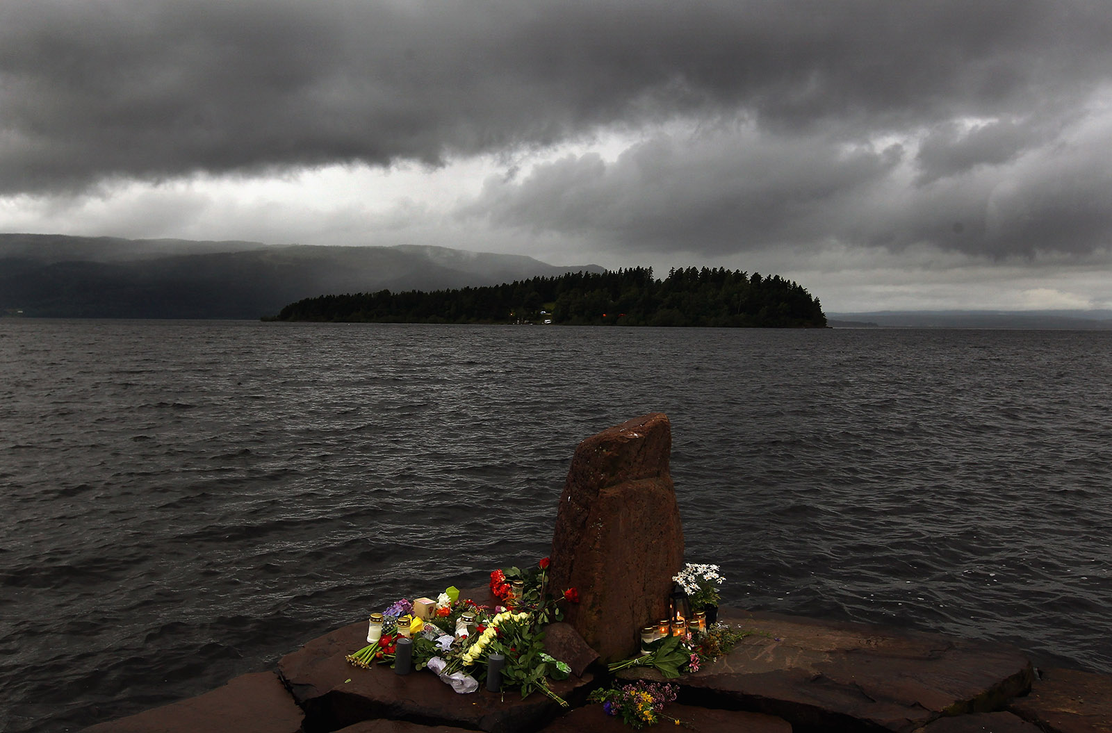 Flowers laid near Utoya Island after Anders Behring Breivik's mass-murder attack, Norway, July 24, 2011