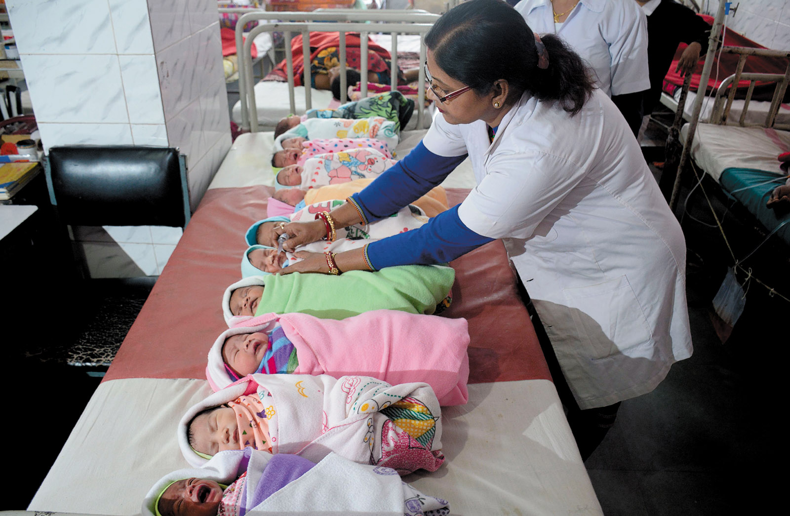 An Indian health official administering polio vaccine drops to newborn babies at a hospital in Agartala, India, as part of a nationwide program to eradicate polio, January 2018