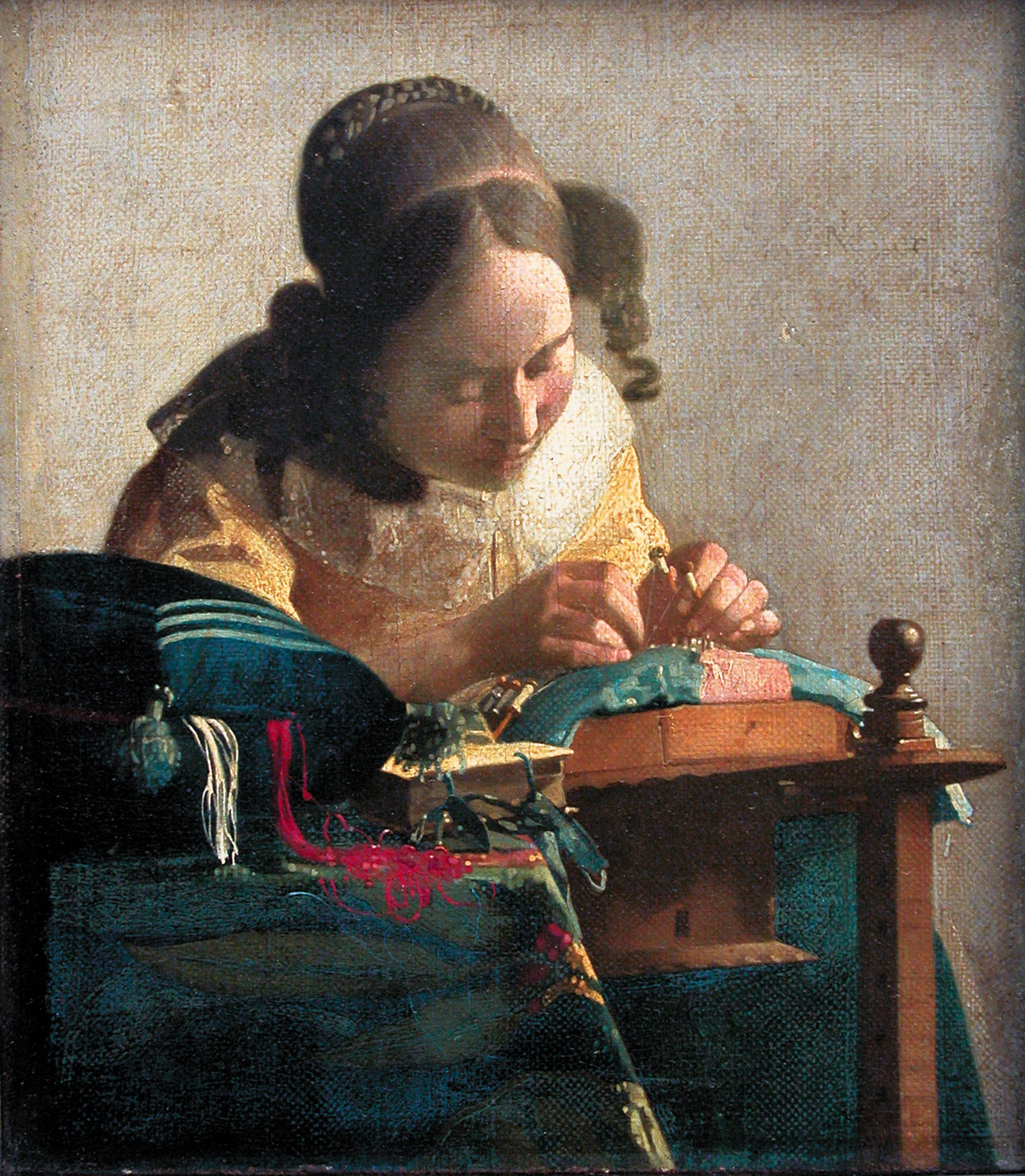 Johannes Vermeer: The Lacemaker, 9 5/8 x 8 1/4 inches, circa 1669–1670