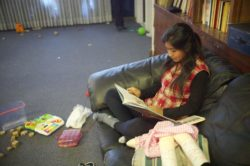 A teenager from Central America in the children's room and library at Nazareth House, El Paso, Texas, December 2018
