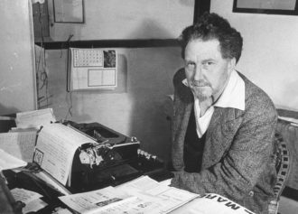 """Ezra Pound composing pro-fascist commentaries on stationary emblazoned with Mussolini's motto """"Liberty Is a Duty, Not a Right,"""" Italy, 1940"""