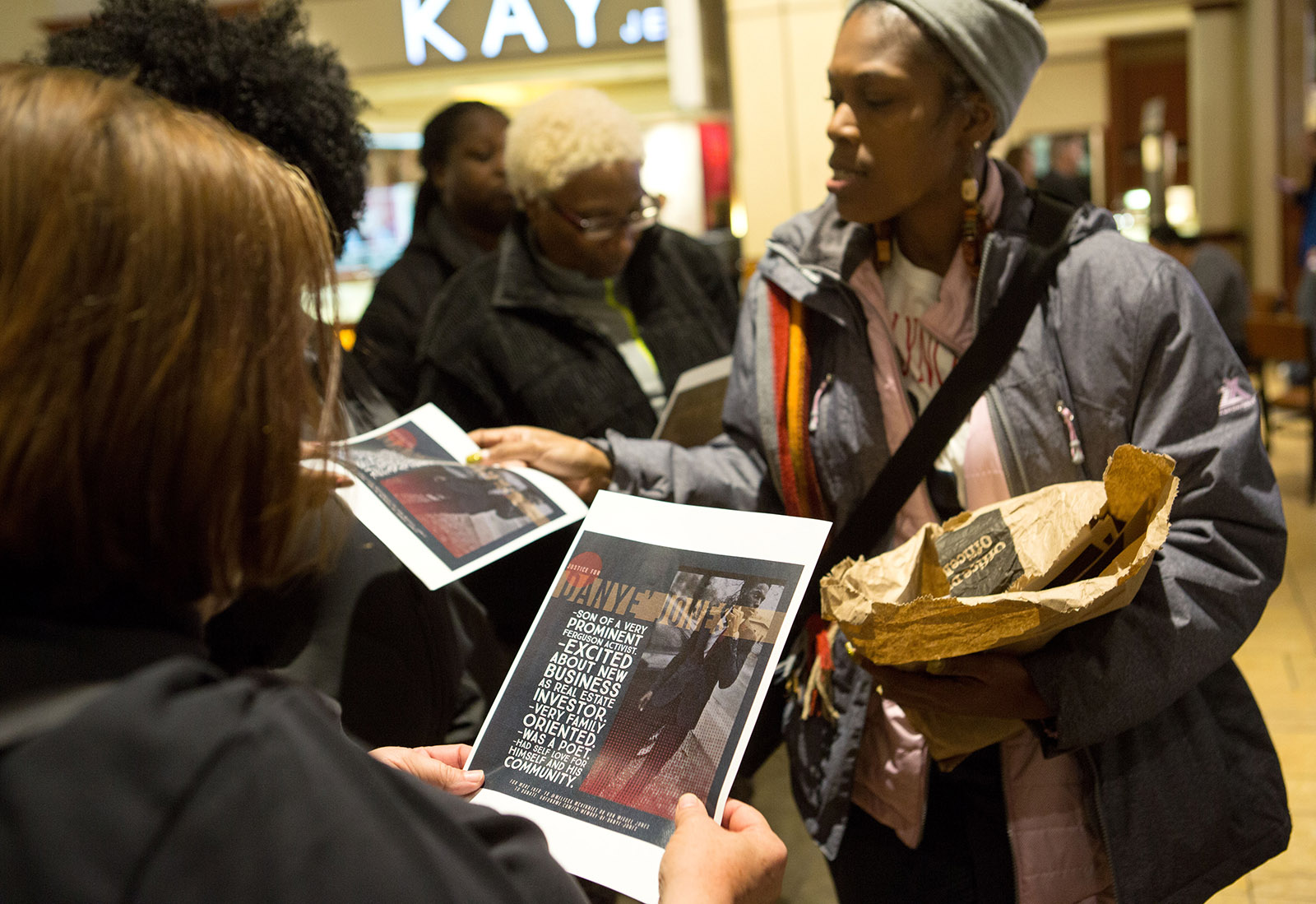 Danye Jones's mother, Melissa McKinnies, handing out flyers concerning the family's efforts to get an investigation of Jones's death, at a St. Louis mall, December 8, 2018