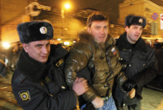Police officers detaining opposition leader Boris Nemtsov during a rally in central Moscow, January 2010