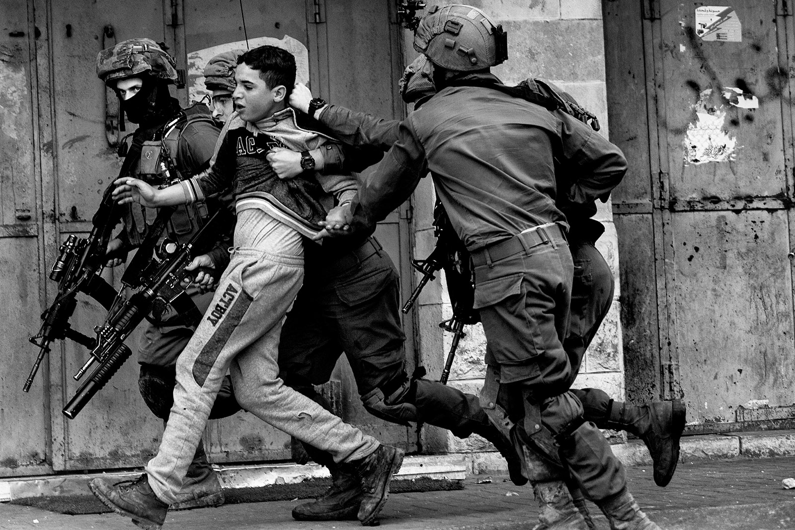 Israeli soldiers detaining a Palestinian during clashes at a protest, Hebron, West Bank, February 2018