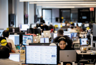 Members of the BuzzFeed staff at the company's headquarters a month before major layoffs were announced, New York City, December 2018