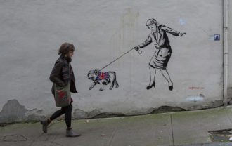 Street art showing Prime Minister Theresa May led by a British bulldog, Glasgow, Scotland, November 2018