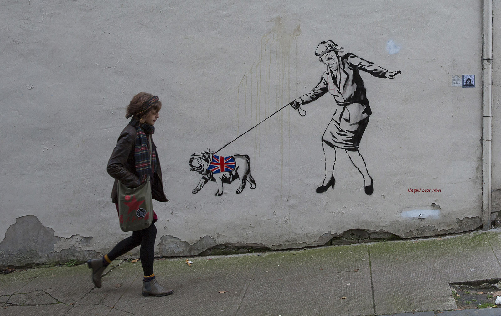 Street art showing Prime Minister Theresa May led by a British bulldog, Glasgow, Scotland, November 2018