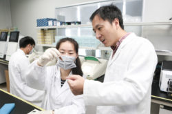 Gene-editing researcher He Jiankui with staff at the Direct Genomics Laboratory, Shenzhen, China, August 4, 2016