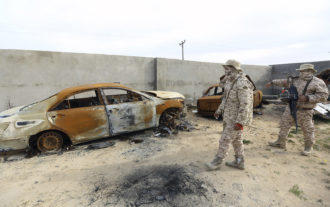 Members of the Tripoli Protection Force, an alliance of militias, inspecting a compound used by the rival Seventh Brigade group in an area south of the Libyan capital, January 18, 2019