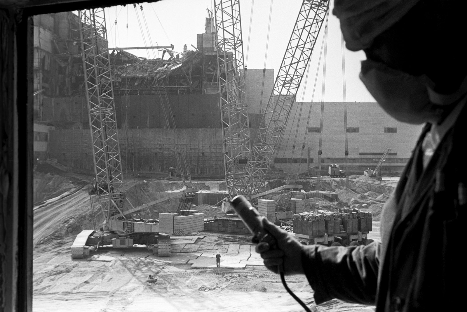 A worker measuring radiation after the explosion at the Chernobyl nuclear power plant in northern Ukraine, August 1986
