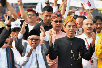 Indonesian president Joko Widodo (right) and his running mate, Ma'ruf Amin, at a peace declaration for the general election campaign, Jakarta, September 2018