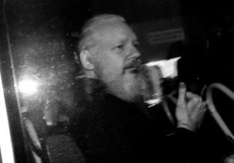 Julian Assange on his way to court following his arrest at the Ecuadorian Embassy, London, England, April 11, 2019