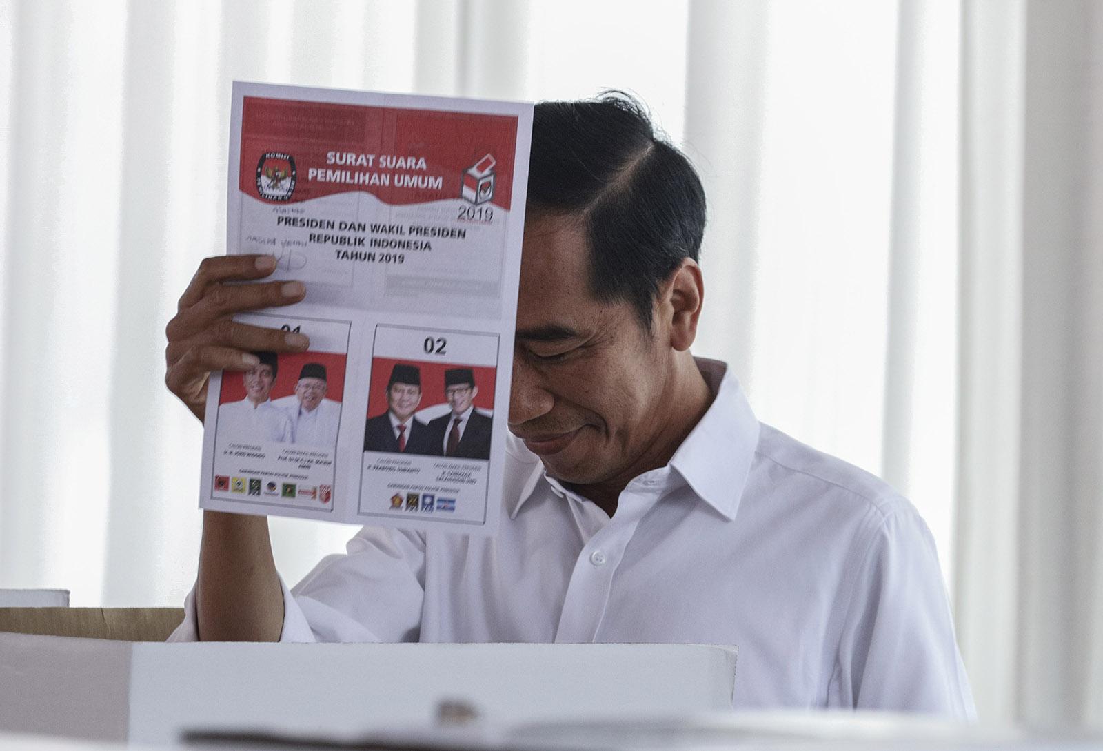 Joko Widodo, the incumbent president, casting his general election ballot, Jakarta, Indonesia, March, 17, 2019