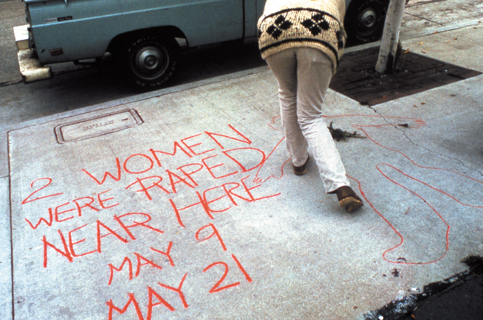 Woman drawing on the sidewalk in Three Weeks in May