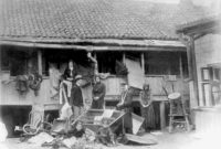 Pogrom victims in front of a vandalized house in the Bessarabian city of Kishinev, on the southwestern edge of the Russian Empire, April 1903