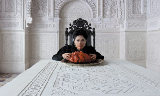 Salma Hayek as a queen eating the heart of a sea dragon in Matteo Garrone's film Tale of Tales (2015), adapted from a set of stories by Giambattista Basile