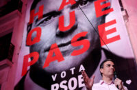 Spanish prime minister and Socialist Party leader Pedro Sánchez addressing supporters outside the PSOE headquarters, its façade covered by a giant election banner, Madrid, April 28, 2019