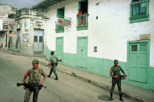 Government troops enforcing a daytime curfew after a massacre in San Vicente de Chucurí, Colombia, 1988