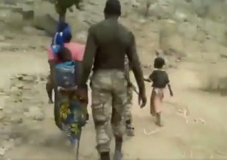 Screengrab from a video analyzed by the BBC's Africa Eye investigation of a summary execution carried out by government soldiers of two women villagers, suspected of links to Boko Haram, and their children, Cameroon, July 2018