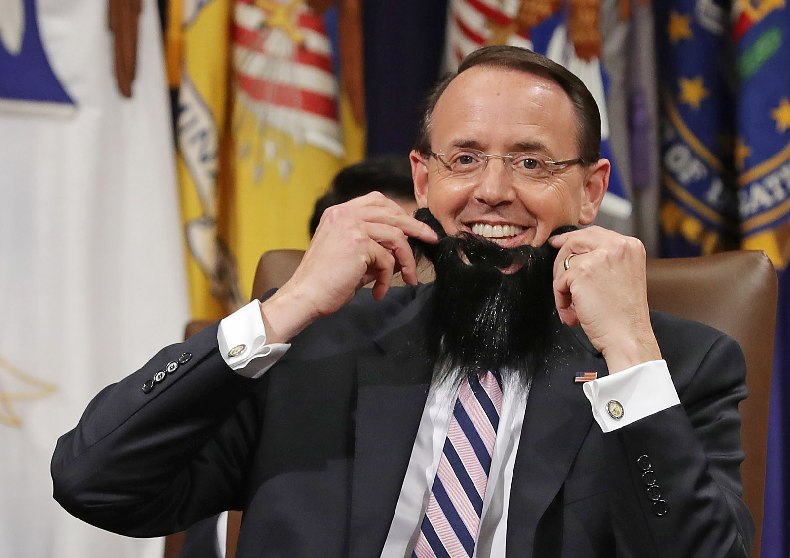 Deputy Attorney General Rod Rosenstein joking with a fake beard donned during his farewell ceremony at the Department of Justice, Washington, D.C., May 9, 2019