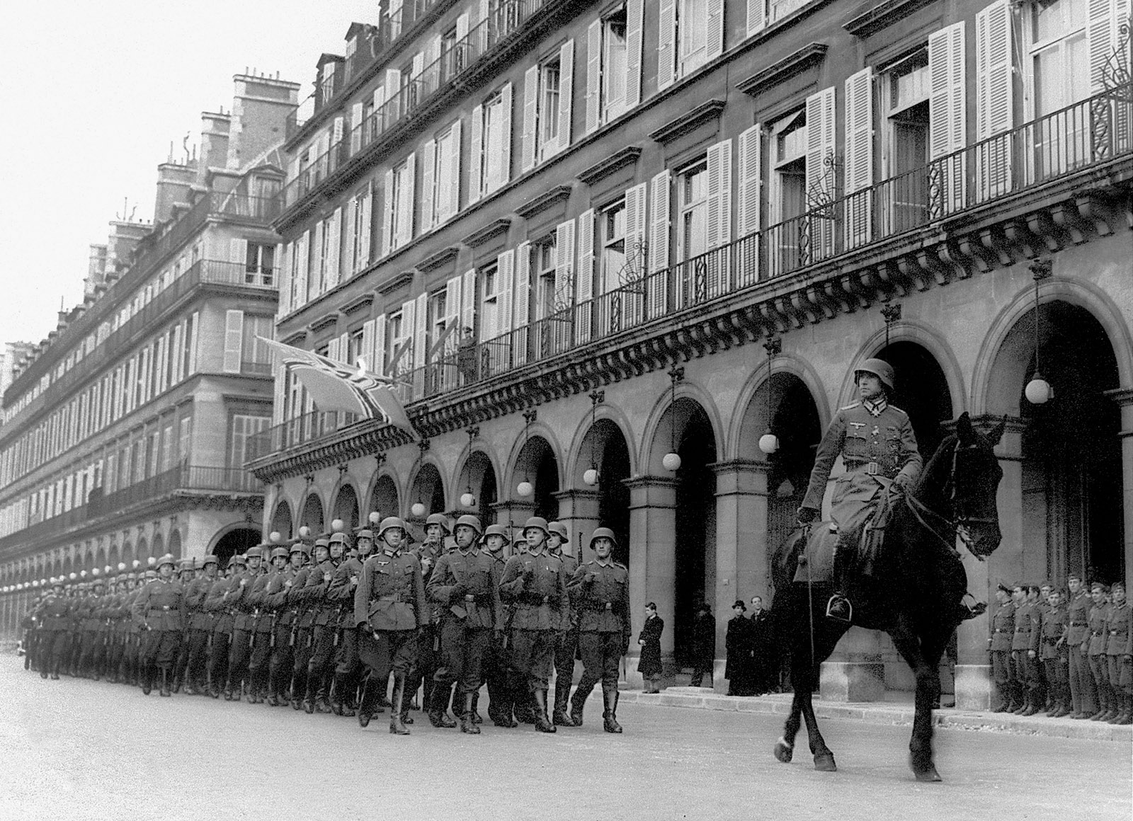 Ernst Jünger on horseback with German troops, Paris, 1941