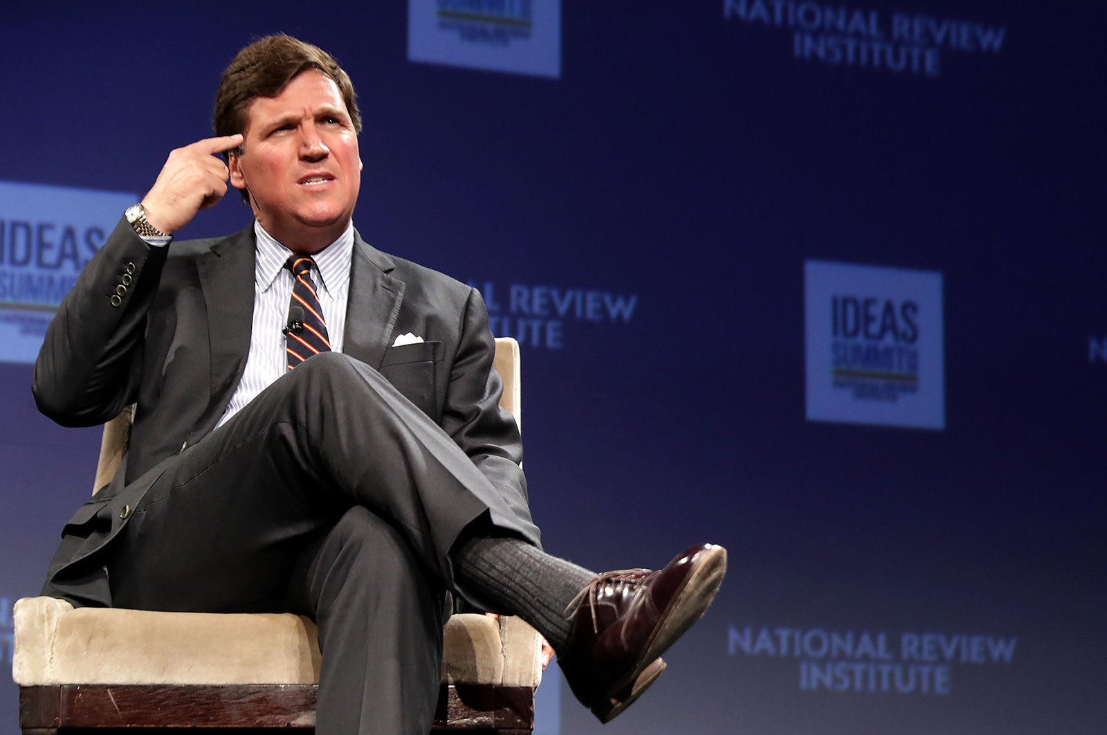 """Fox News host Tucker Carlson discusses """"Populism and the Right"""" at a National Review Institute conference, Washington, D.C., March 29, 2019"""
