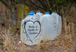 Jugs of water left along migrant trails by the humanitarian aid group No More Deaths, for which Scott Warren volunteers, near Ajo, Arizona, May 10, 2019