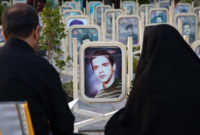 Parents at the tomb of their son killed in the Iran–Iraq War at the Martyrs' Cemetery, Isfahan, Iran, October 14, 2016