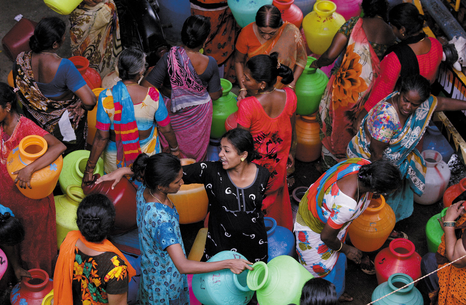 Residents filling containers with water from a municipal tanker in Chennai, India, June 2019