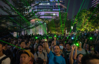 Laser pointers being used by protesters in Hong Kong in an effort to defeat surveillance cameras and facial recognition software used by the authorities, China, August 7, 2019