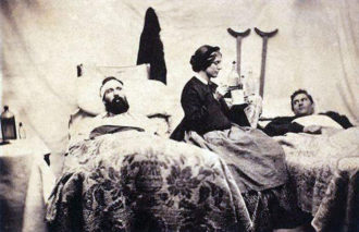 Wounded soldiers resting with a nurse, Civil War, circa 1864