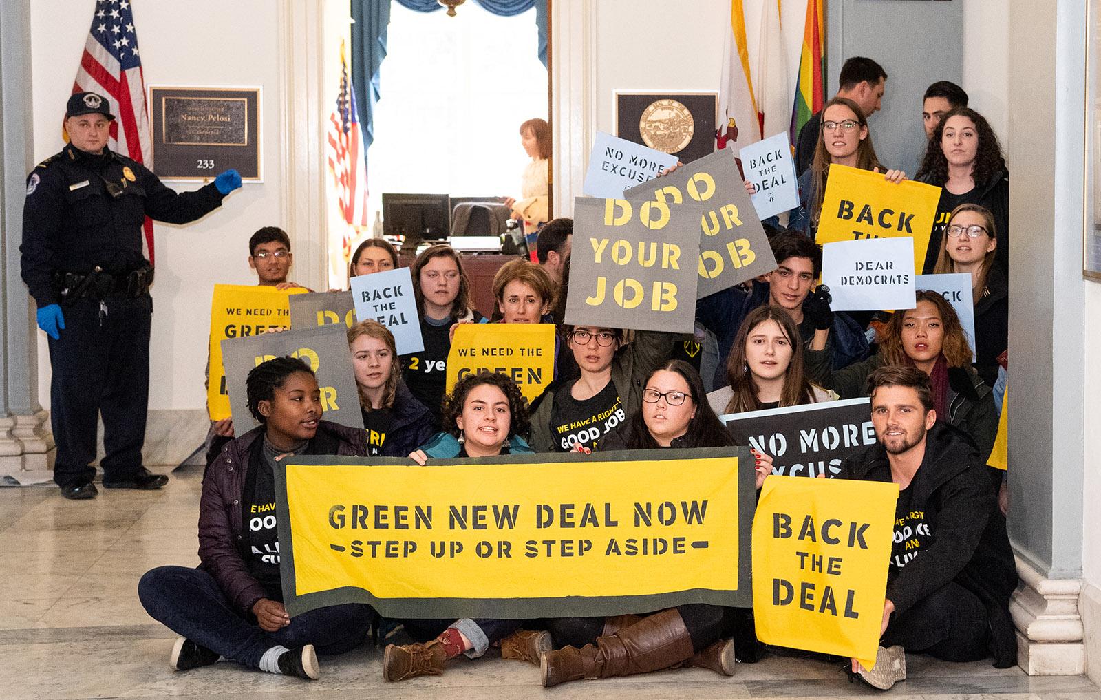 Sunrise Movement protesters inside the office of Democratic House Speaker Nancy Pelosi, Capitol, Washington, D.C., December 10, 2018