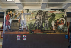A fresco from Victor Arnautoff's The Life of George Washington showing Washington pointing west, as ghostly frontiersmen advance to destroy the Native American way of life, George Washington High School, San Francisco