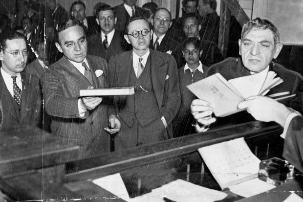 Morris Ernst (second from left) defending Gustave Flaubert's <i>November</i> in court against charges of obscenity, New York City, 1935