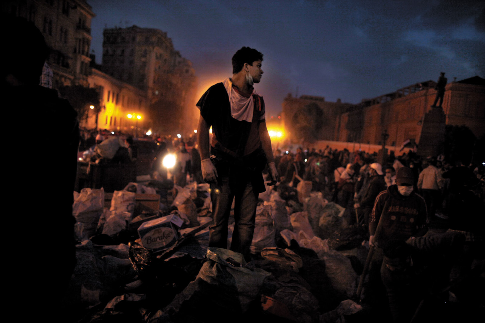 Volunteers clearing trash and debris from Tahrir Square, Cairo, February 2011