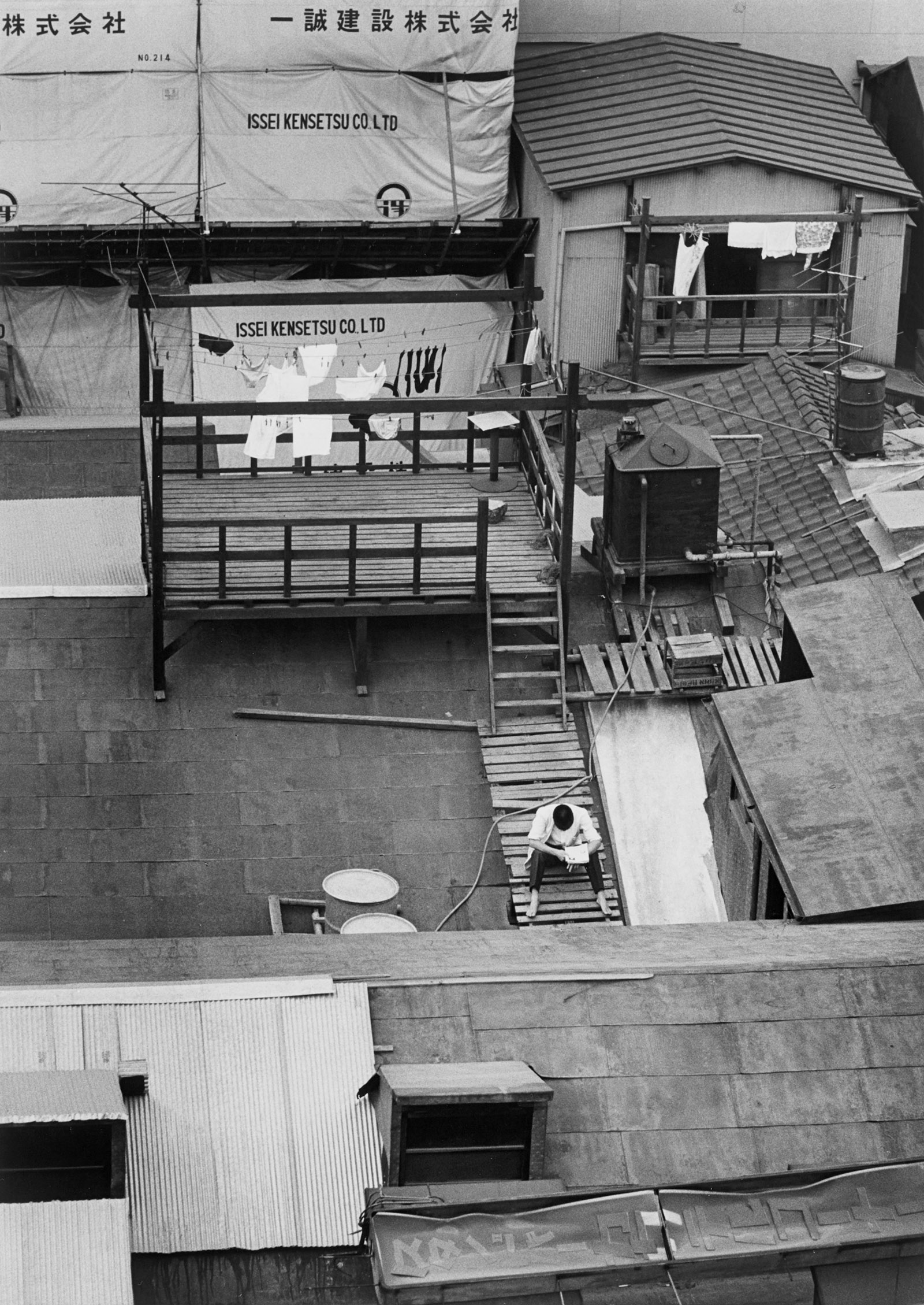 Photograph of apartment building rooftop by Yasuhiro Ishimoto