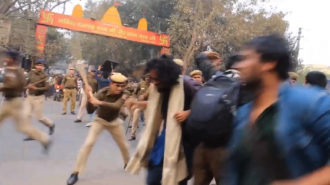 A still from Vivek showing police beating students who were protesting in front of the RSS headquarters in Delhi following the induced suicide of the scholar Rohith Vemula