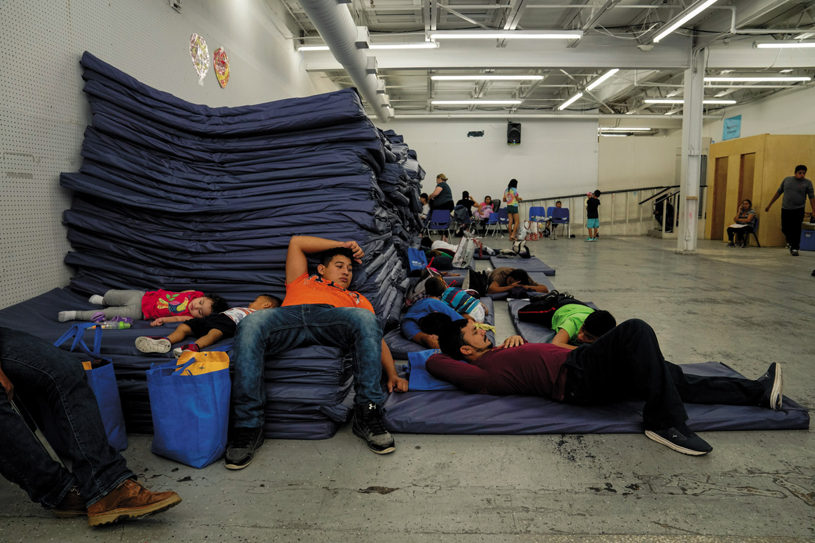 Asylum-seekers at the Humanitarian Respite Center, McAllen, Texas, August 2019