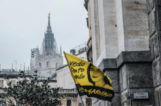 A flag with the anti-mafia slogan 'I see, I hear, I speak' and a picture of Lea Garofalo at her funeral, Milan, 2009. Garofalo was killed by the 'Ndrangheta after testifying against her husband and brother, who were members.