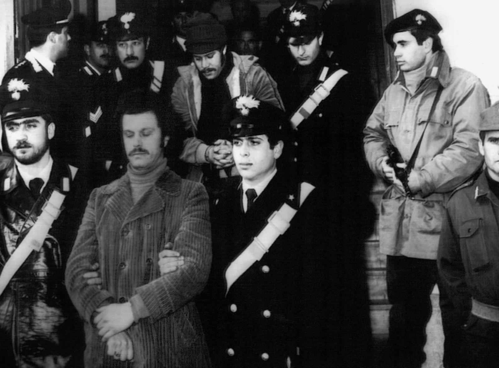 Two suspected 'Ndrangheta members being escorted to prison, Reggio Calabria, 1981