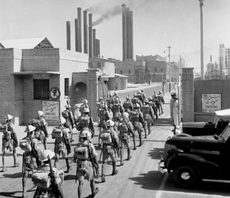 Indian troops under British command entering the Abadan oil refinery in Iran, 1941
