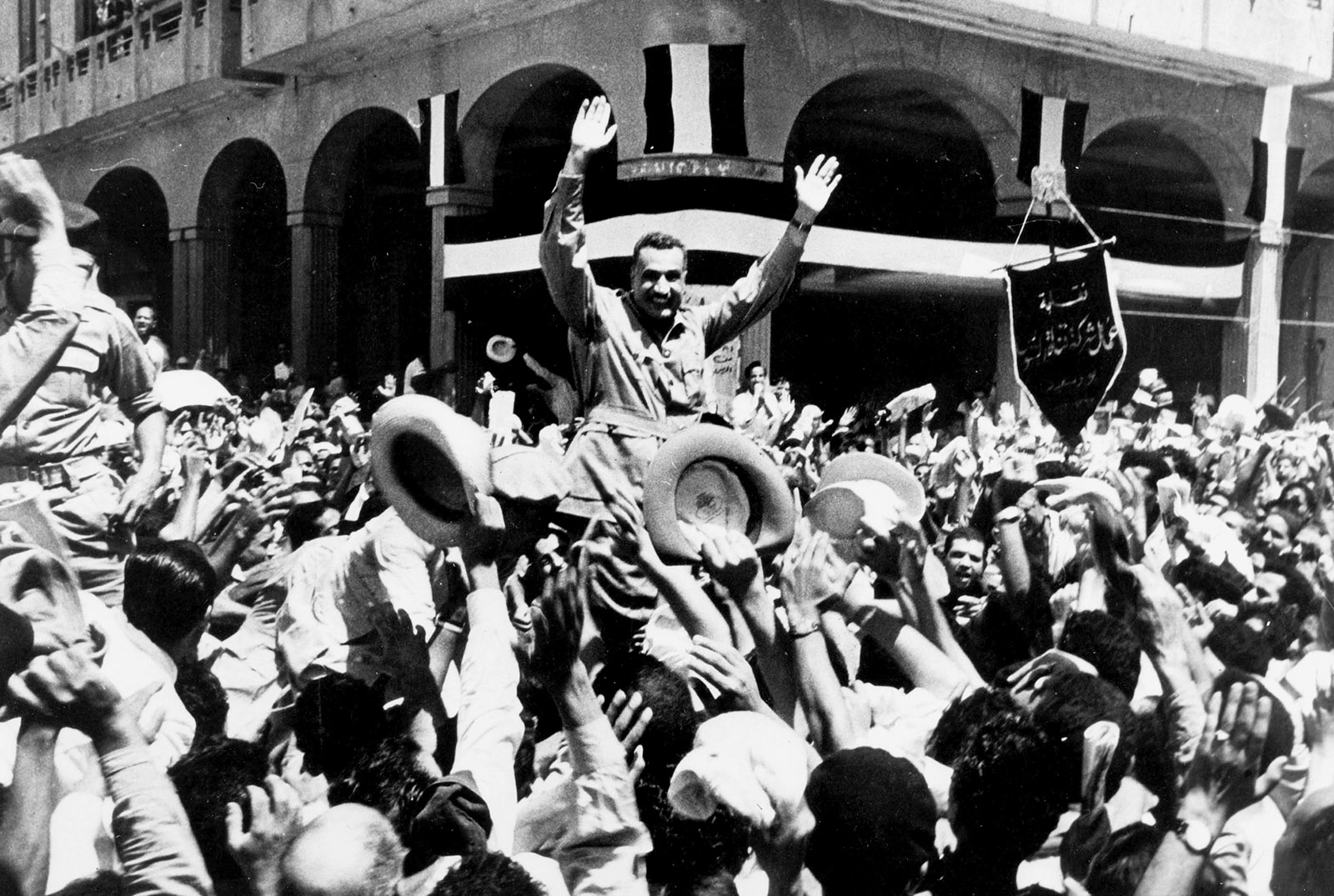 Gamal Abdel Nasser being carried through the streets after the British evacuation from the Suez Canal, Port Said, Egypt, 1956