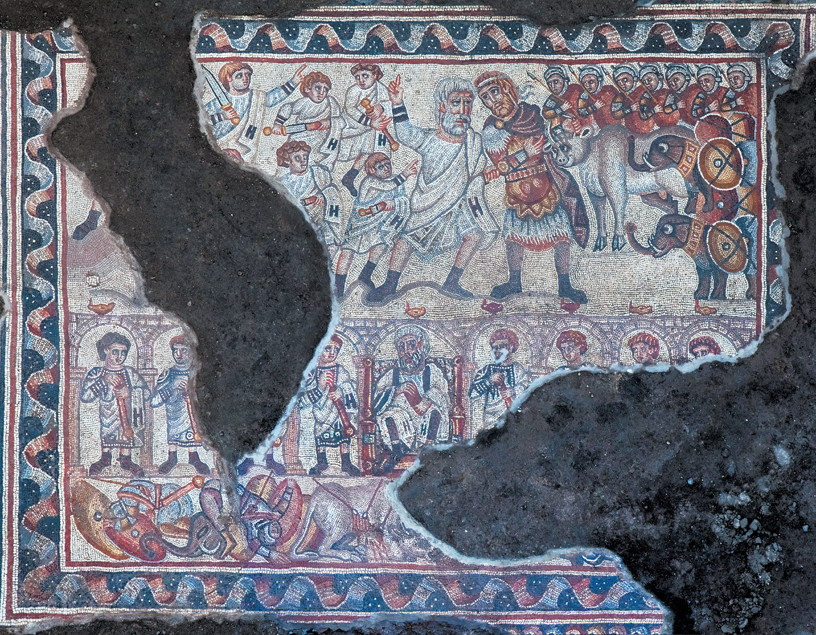 A portion of a mosaic excavated between 2013 and 2015 from the Huqoq synagogue, likely depicting the resistance of the Maccabees to the Seleucid king Antiochus IV in the mid-second century BCE, Lower Galilee, Israel; photograph by Jim Haberman