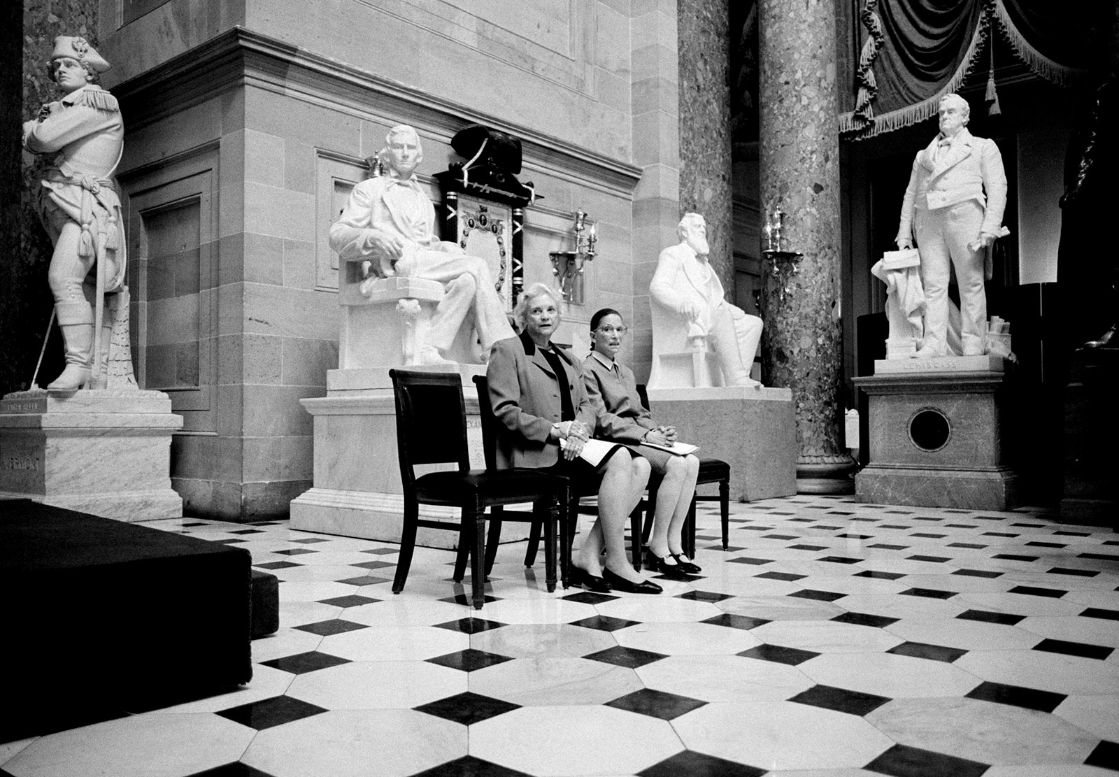 Sandra Day O'Connor and Ruth Bader Ginsburg preparing to address a meeting of the Congressional Women's Caucus, Washington, D.C., 2001