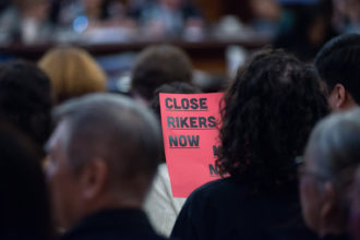 Audience members at the New York City Council hearing on the closure of the Rikers Island Jail and the building of four borough-based jails, New York City Hall, September 5, 2019