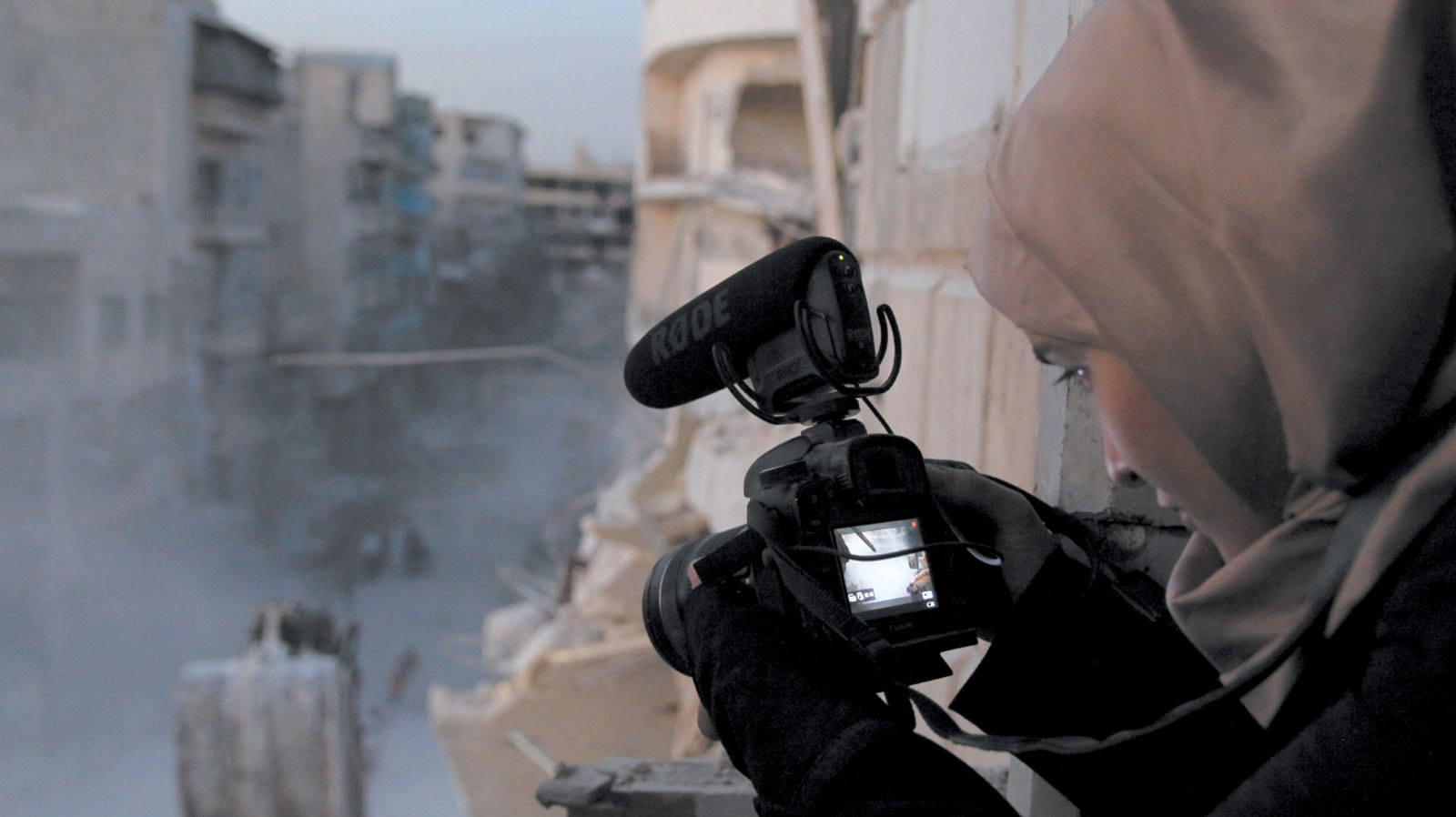 Waad al-Kateab filming the ruins of a building destroyed by bombing, east Aleppo, October 2016
