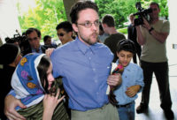 Brandon Mayfield and his children outside a federal courthouse after his release from custody, Portland, Oregon, May 2004. Mayfield was arrested after fingerprints on a bag found near the site of the 2004 Madrid bombings were mistakenly identified as his.