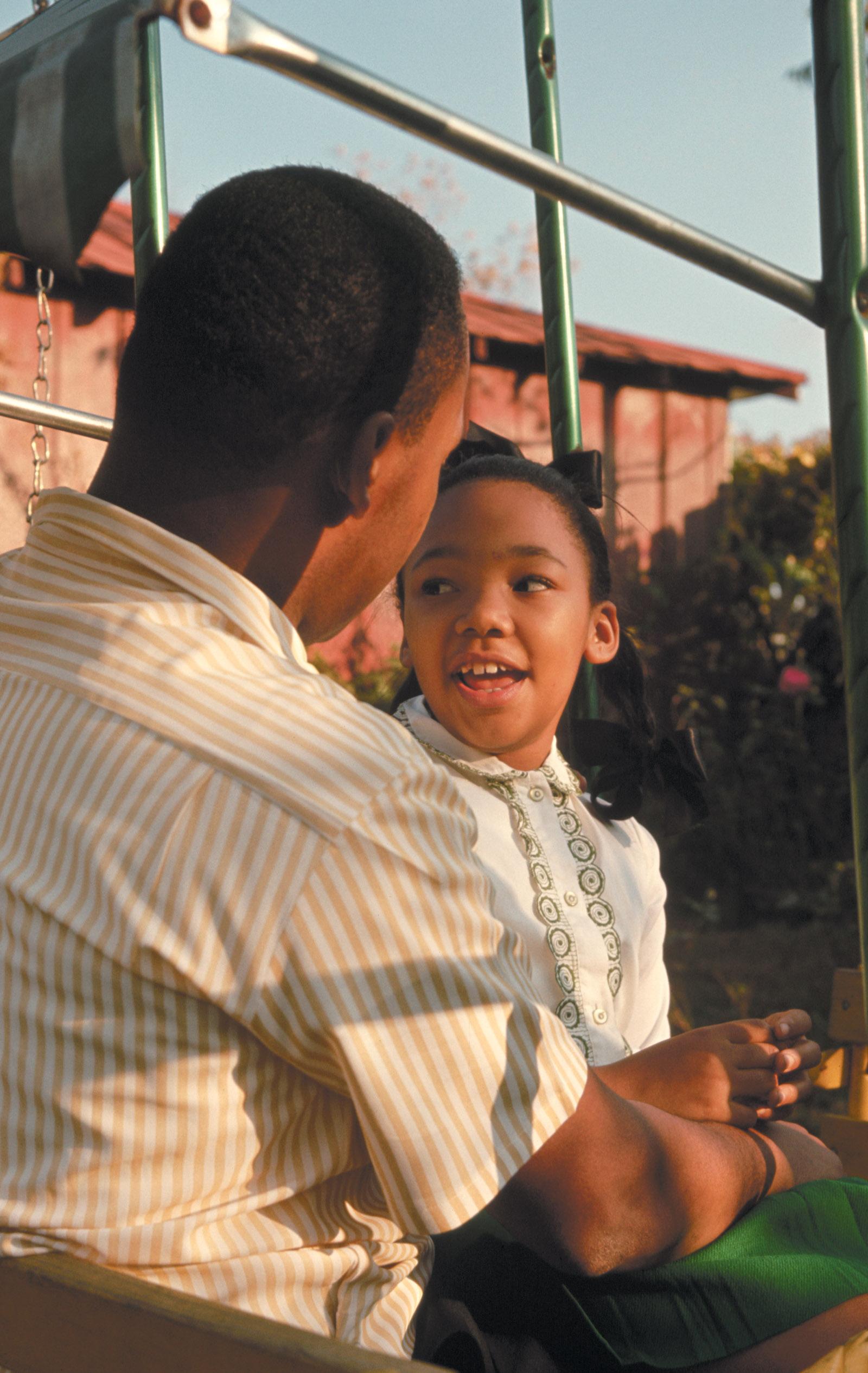 Martin Luther King Jr. with his daughter Yolanda in their backyard, Atlanta, 1964
