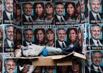 A homeless man sleeping under posters of newly elected President Alberto Fernández and his running mate, Vice-President Cristina Fernández de Kirchner, Buenos Aires, October 28, 2019