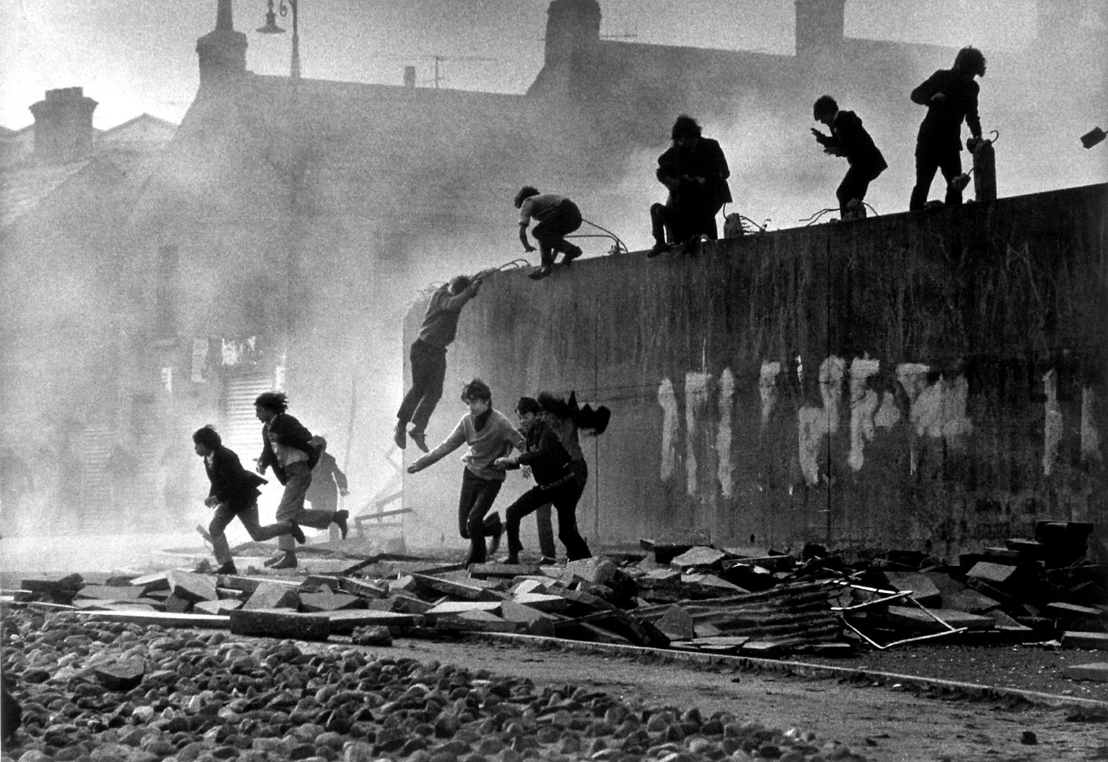 People jumping off a wall, Londonderry, Northern Ireland, 1971
